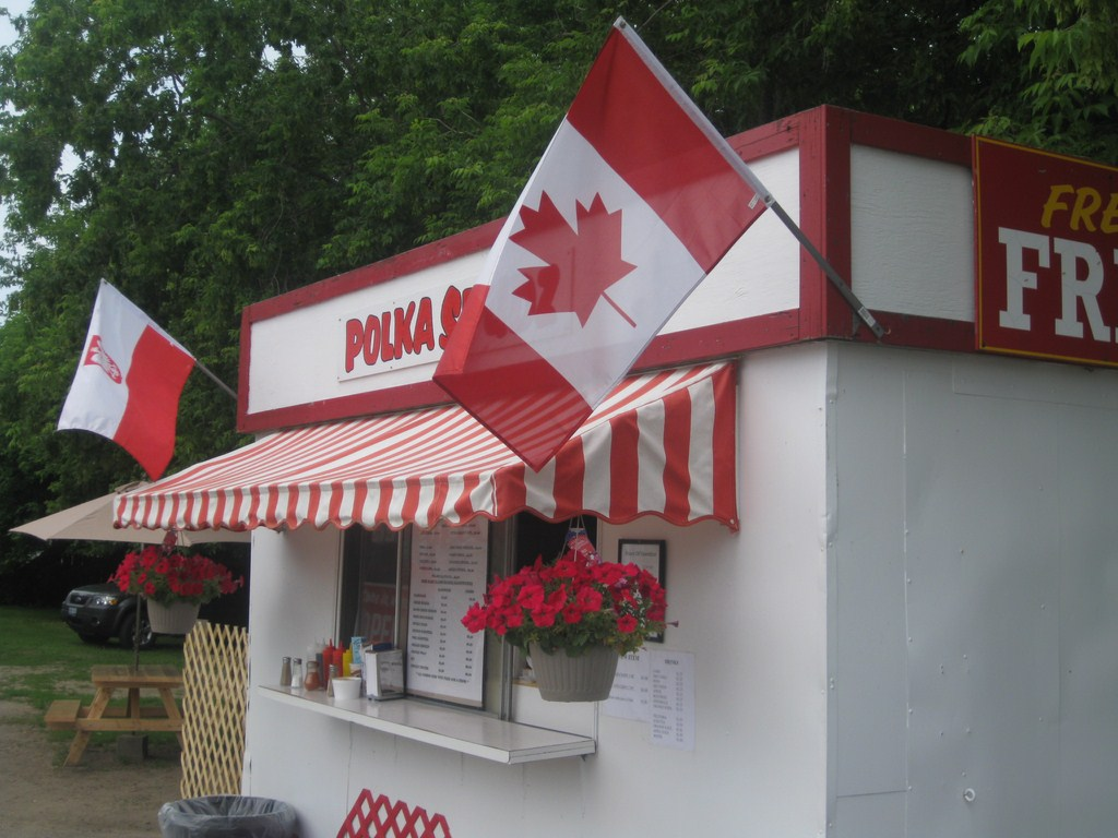 red and white food truck with Polish and Canadian flags
